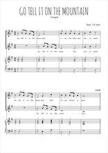 Téléchargez la partition de Go tell it on the mountain en PDF pour 2 voix égales et piano